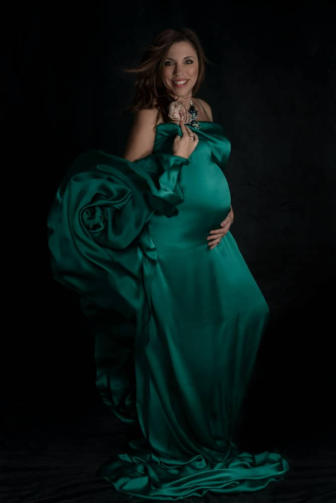 Expecting woman in emerald green dress