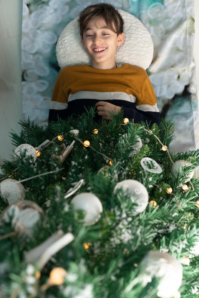 Boy under Christmas tree